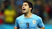 Luis Suarez keeps Uruguay alive in World Cup