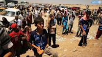 Thousands Of Yazidi Flee ISIS And Into Syria