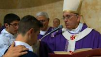 Pope holds mass at parish in the outskirts of Rome