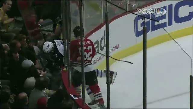 Bollig sends Pardy through the glass on hit