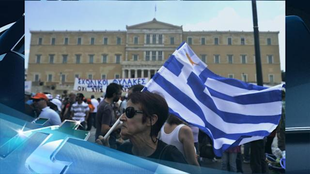 Breaking News Headlines: Greece Hit by General Strike Over State Job Cuts