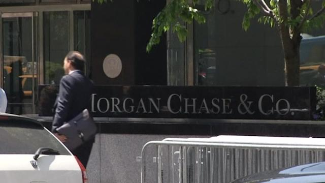 JPMorgan makes $5 bln settlement; S&P 500 record