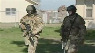 House-By-House Search By SWAT Team