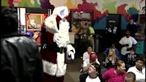 Children receive gifts at Wednesday's Child Christmas party
