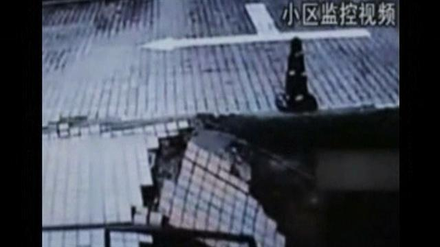 Camera captures man swallowed by sinkhole