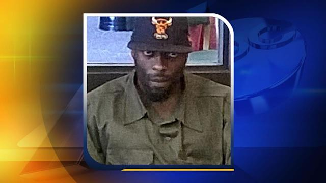 Officials search for suspect accused of lewd act at library