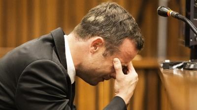 Raw: Pistorius Covers Head During Testimony