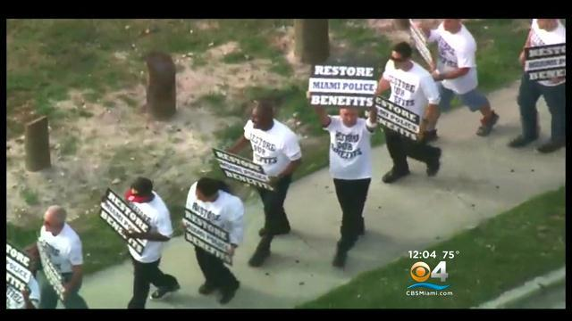 Miami Police March To City Hall To Protest Cuts