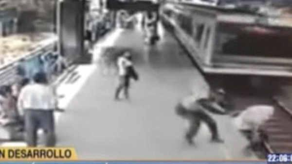 Cop in Colombia saves man from train jump