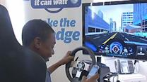 Students try texting and driving on simulator