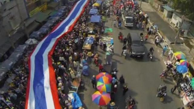 Thai protesters march, after election ruling