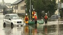 Floods in Japan kill 26, thousands still cut off