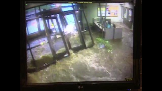 RAW: Flood waters bust through campus front doors