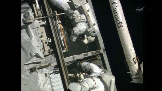Spacewalking astronauts fix broken computer