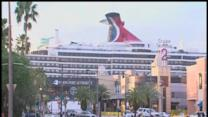 passengers wait to disembark troubled cruise ship