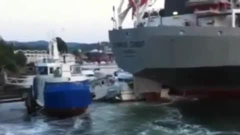 Massive Ship Crashes Into Boats