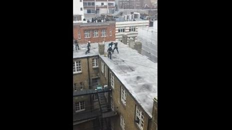 Police tackle G8 protester on rooftop