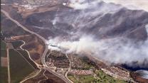 Winds spur new wildfires near SoCal homes