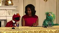 Michelle Obama and Elmo compare muscles