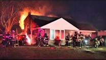 NY firefighter battles blaze at his own home