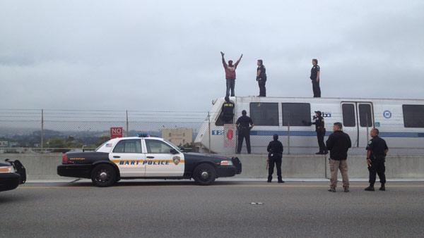 Man on top of BART train in Oakland delays trains
