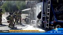 Four vehicles damaged in car carrier fire