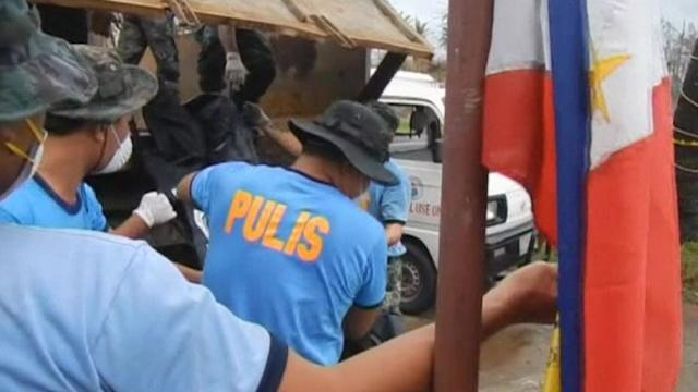 Philippine forensic workers begin identifying typhoon victims