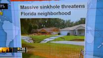 Headlines at 7:30: Massive sinkhole threatens homes in central Florida