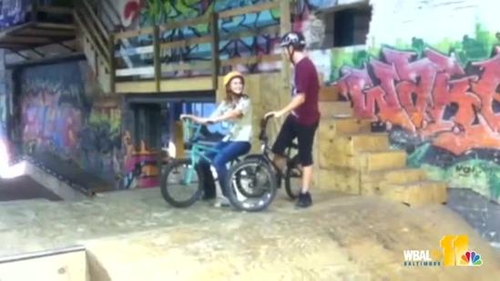 BMX rider jumps over Ava with bike