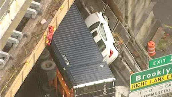 Truck nearly pushed car over the edge on BQE