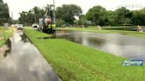 West Palm Beach employees use truck to get rid of floodwater