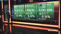 Asia markets open higher amid slew of economic data