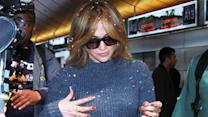 Jennifer Lopez Gets Confetti Bombed At Airport!