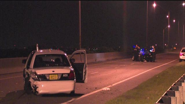 Police say a driver racing on the Courtney Campbell Causeway crashed into a Tampa officer's cruiser