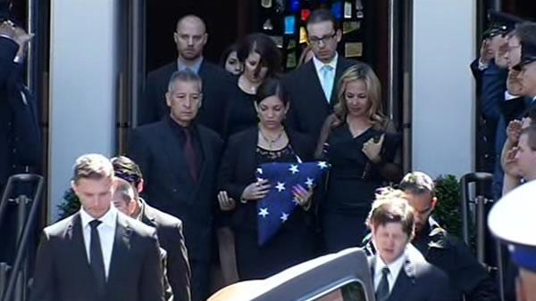 5 teens arrested as murdered paramedic is laid to rest