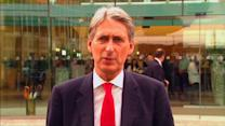 """UK's Hammond: """"clear will"""" to complete Iran deal"""