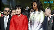 Michelle Obama Glistens in Chic Rainbow-Print Ensemble