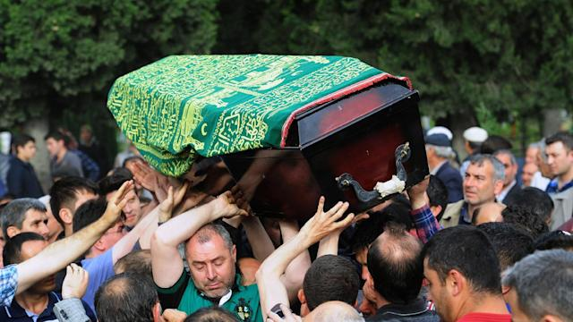 Searching for answers as the dead are buried in Turkey