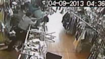 Clerk fights back against robber with bat