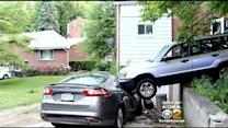 SUV Crashes Into Porch In Forest Hills, Misses 6 People By Just A Few Feet