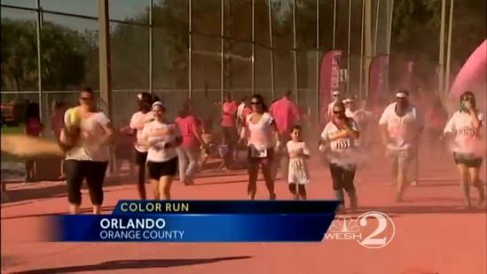 Runners doused with paint in Orlando Color Run