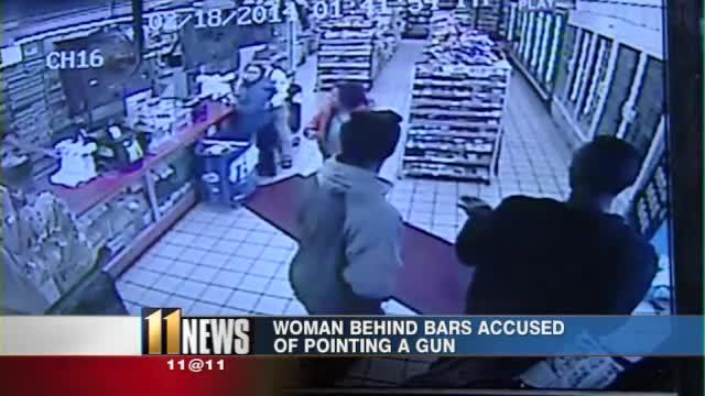 POLICE: Woman points gun at people in store, leaves