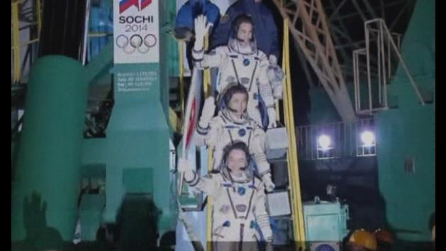 Olympic torch sent into space on Soyuz rocket