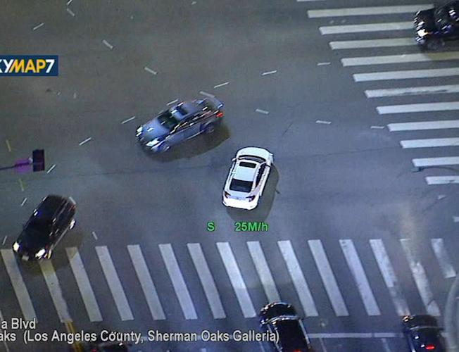 Police chase car stolen at gunpoint from Van Nuys dealership