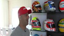 Tony Kanaan shows off his wall of racing helmets