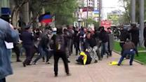 Ukraine government supporters and separatists battle in streets