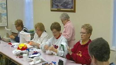 Group Crafts T-Shirts Into Diapers For Haiti