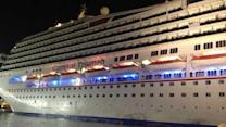 Crippled cruise ship Triumph arrives in Mobile, AL