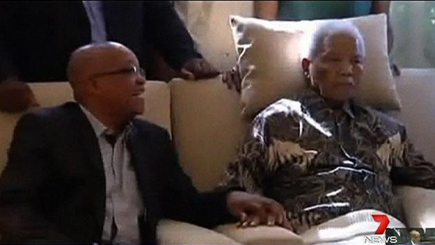 Mandela improving, condition still serious