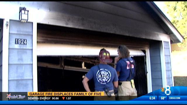 Garage fire displaces family of five